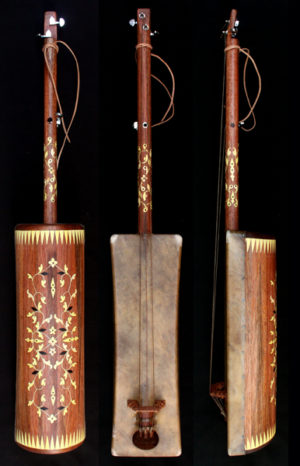 Buy a guembri with tuning keys. Handmade instrument by Hassan Laarousi. Body mahogni and neck mahogni. Decoration lemon tree. Dromedary skin and original goat strings form Morocco. No: 58/120.1 Full length 120 cm. Body 58 cm The price is included a black guembri bag and one/1 set of originial goat strings. (1 set of strings are 3 pieces of goat strings ) Price: 300 Euro SOLD to a musician from France Accessories for guembri instrument Ordering and shipping Various of guembri, #guembrihassan,
