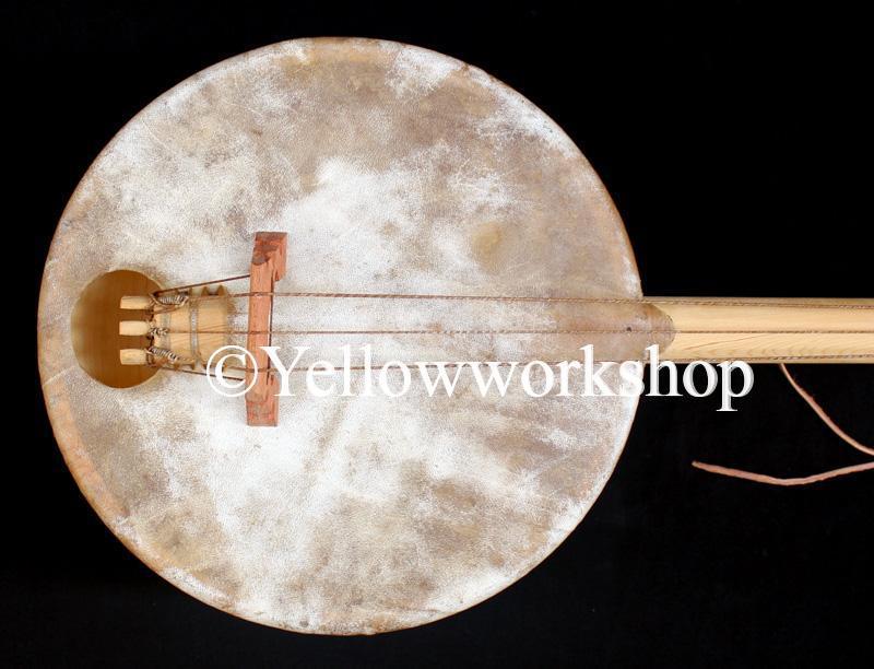 moroccan instrument bass guitar Gnawa Maalem Guembri Sounds essaouira activites essaouira attraction