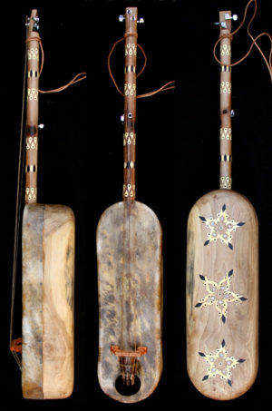 gnawa´s musical instrument play guembri guembri for sale de guembri, la guembri gnaouacuture Moroccan Sintir also called Guembri bass guitar De Marokkaanse basguitar guembri tuning what is the correct tuning for the 3 stringed morrocan bass How to tune the guimbri